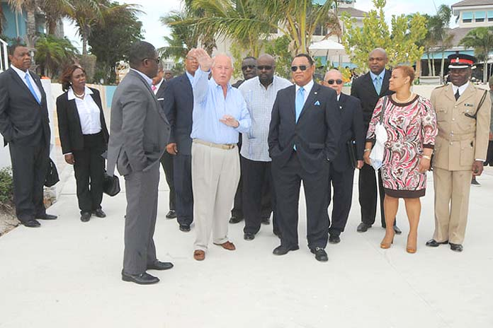 February Point Investor John McGarvey, centre left, directs a tour of the re-developing property with Prime Minister the Rt. Hon. Perry G. Christie, centre right, and Government Ministers Hope Strachan, Kenred Dorsett, Khaalis Rolle, and other officials. (BIS Photo/Peter Ramsay)