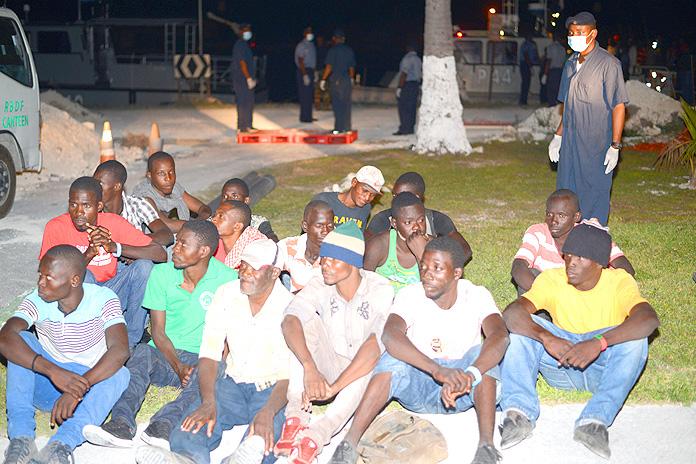 Migrants awaiting processing onboard HMBS Coral Harbour (Photo: Marine Seaman Stefan McDonald)