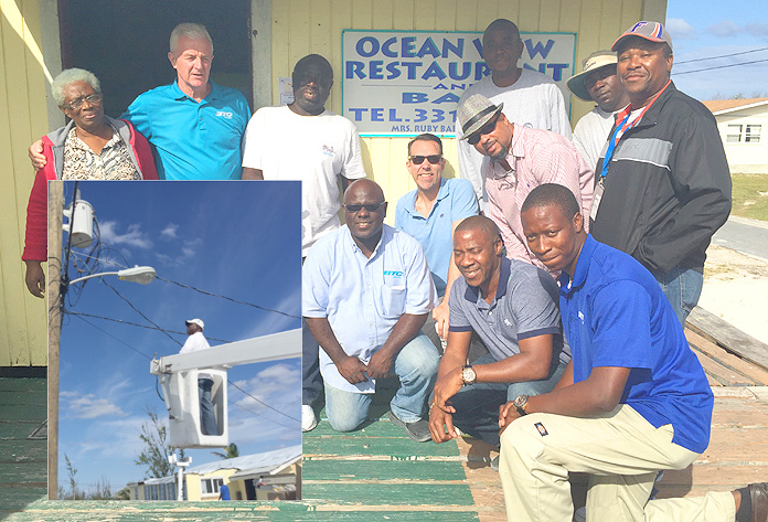 "Business owner Trevellyn Bain welcomes the BTC Team with a ""thumbs up"" as they prepare to install FLOW TV at the Ocean View Restaurant and Bar. BTC has been working tirelessly to repair damage from Hurricane Joaquin and to prepare Rum Cay for FTTH and FLOW TV."