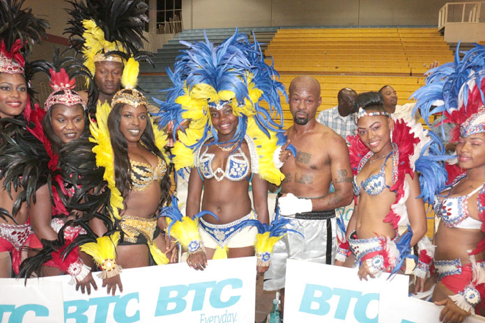 Boxer Meacher 'Major Pain' Major flanked by Carnival Dolls at the Caribbean Showdown boxing event in Nassau.