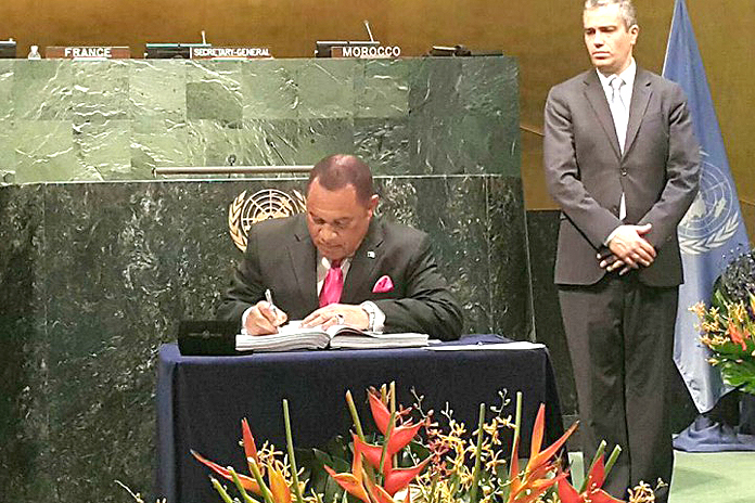 Prime Minister Christie signs historic Climate Change Agreement at the United Nations.