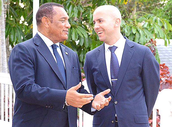Deputy Assistant Secretary for Western Hemisphere Affairs Juan Gonzalez speaks with Prime Minister of The Bahamas the Rt. Hon. Perry Christie during a reception at the U.S. Ambassador's Residence. (Photo courtesy Peter Ramsay, BIS)