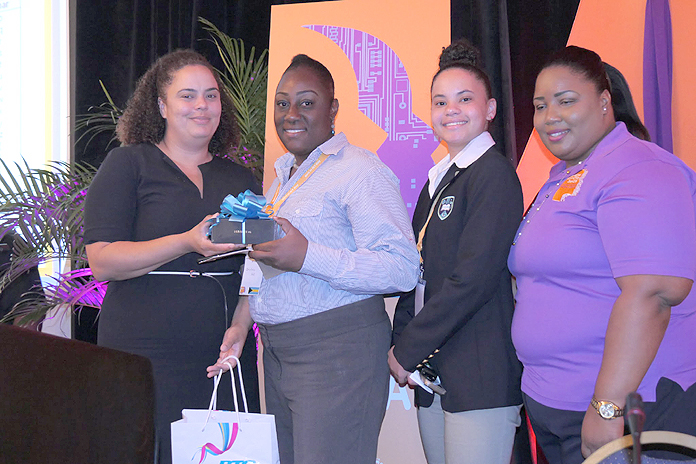 Neisha Butler (VP, Financial Analysis & Planning) presents students with prizes.
