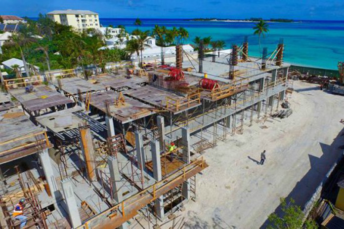 Local contractors and more than 150 Bahamian workers are on site at ONE Cable Beach, a luxury condo project by Aristo Development just west of Melia Nassau Beach Resort, West Bay Street. Bahamian subcontractors on the $70 million development include Mosko/Bahamas Marine and Greyco Limited. This March 14th aerial view of the $70 million ONE Cable Beach luxury condominium project shows multi-million dollar construction activity including the concrete pour of the third floor.