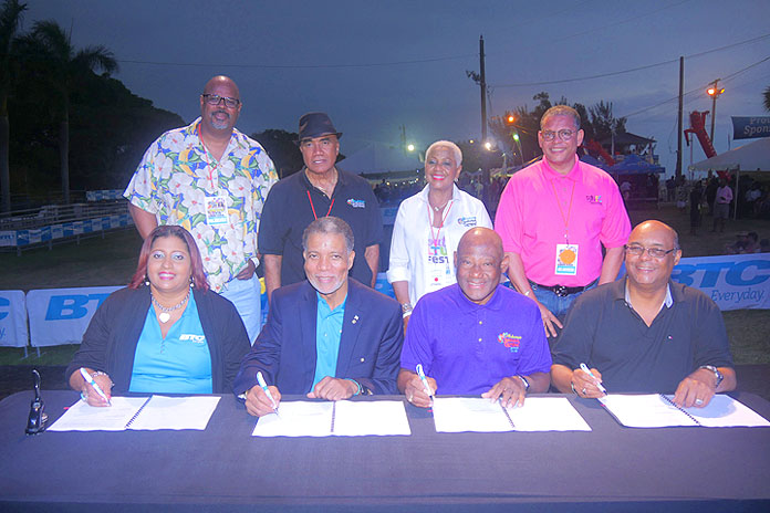 Members of the Carnival Committee sits down with BTC CEO Leon Williams at contract signing.