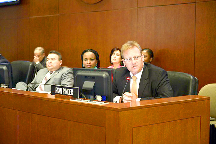 Ryan Pinder (right), former Bahamas Financial Services Minister and Member of Parliament for the Elisabeth Constituency in New Providence, addressing a special meeting of the Permanent Council of the OAS on Wednesday, March 30, 2016. Also pictured from left are: OAS Assistant Secretary General Nestor Mendez and Ms. La Celia A. Prince, Chief of Staff to the OAS Assistant Secretary General. (Photo by Juan Manuel Herrera/OAS).