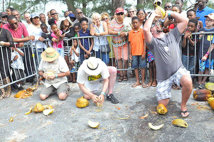 Visitors Joined In -- Coconut Barking Competition at the 18th Annual Pelican Point Coconut Festival held March 28 in Pelican Point, Grand Bahama. (BIS Photo)