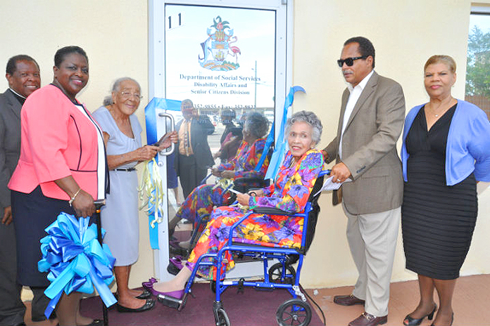 As a part of the official opening of the Department of Social Services Disability Affairs and Senior Citizens Divisions of the Ministry of Social Services and Community Development on Friday, May 13, 2016 there was a ribbon cutting ceremony. Shown from left are: Pastor Peter Pinder, president, Grand Bahama Christian Council; the Hon. Melanie Griffin, Minister of Social Services and Community Development; Ms. Jacqueline Bowe, a 95-year-old resident of Holmes Rock, West Grand Bahama; Lady Laurie Miller; Russell Miller, son of Lady Laurie; and Mrs. Lillian Quant-Forbes, Senior Deputy Director, Ministry of Social Services and Community Development. (BIS Photo/Vandyke Hepburn)