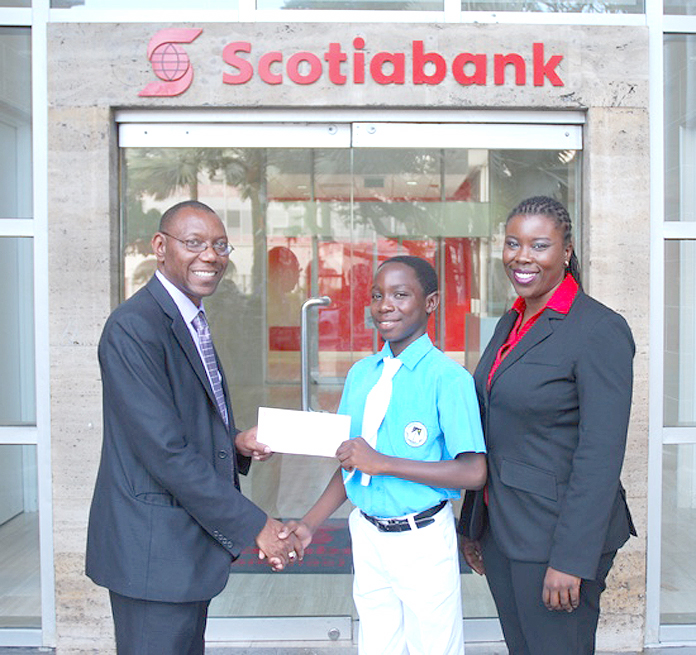 Mr. Ricardo Deveaux, Aquinas College student Dariq Chase and Maxine Seymour from Scotia Bank.