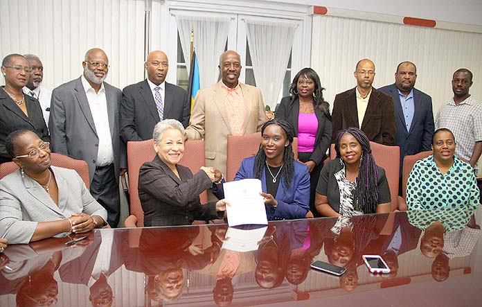 A new industrial agreement has been signed between the Government of the Bahamas and the Bahamas Air Traffic Control Union (BATCU). The agreement was signed on Friday, May 27 at the Ministry of the Public Service.  Pictured L-R: Permanent Secretary, Ministry of the Public Service, Hyacinth Pratt-Winder; Minister of Transport and Aviation, the Hon. Glenys Hanna-Martin; President of BATCU Lashan Gray; Secretary General (BATCU) Erica Symonette and Treasurer (BATCU) Karen Bartlett. Also pictured standing is Minister of Labour, National Insurance, and the Public Service the Hon. D. Shane Gibson, flanked by Public Service Ministry personnel. (BIS Photos/Patrick Hanna)