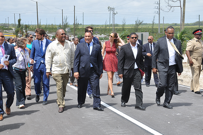 WALKING THE BRIDGE - Following the opening ceremony of the Sir Jack Hayward Bridge, the Prime Minister of The Bahamas, the Rt. Hon. Perry G. Christie (centre); Minister for Grand Bahama, the Hon. Dr. Michael Darville (right); the Hon. K. Peter Turnquest, Deputy Leader of the Free National Movement and Member of Parliament for East Grand Bahama (on Prime Minister's left); the Hon. Neko Grant, Member of Parliament for Central Grand Bahama (on Prime Minister's right), along with Hayward and St. George families, walked to the top of the bridge to participate in the unveiling of the plaque and the ribbon cutting. (BIS Photo/Vandyke Hepburn)