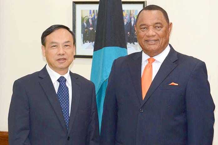 PM Christie along with China's Ambassador HE Huang Qinguo.