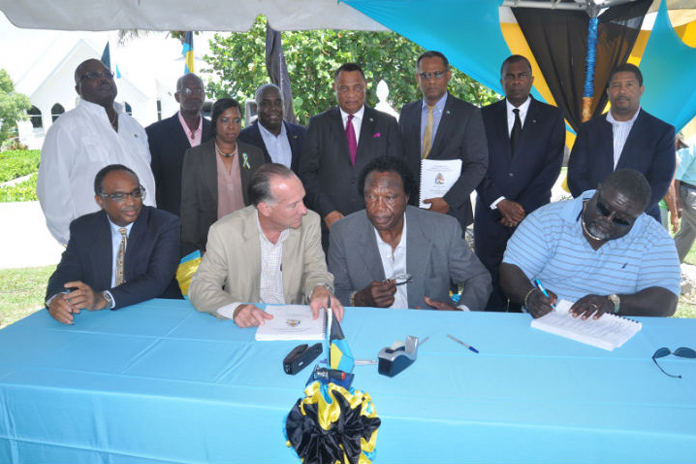 The Bahamas Government signed a contract for the construction of a Seawall in Smith's Point in Freeport, Grand Bahama, Friday, June 24, 2016. Pictured sitting from left are Melvin Seymour, Permanent Secretary, Ministry for Grand Bahama; Colin Higgs, Permanent Secretary, Ministry of Works and Urban Development; Washington Smith, Owner, Smith's Construction and Teneil Smith, Smith's Construction. Standing from left are: Arnold Forbes, Minister of State, Ministry of Works and Urban Development; Clifford Edden, Councillor, Smith's Point Township; Toni Hudson-Bannister, Assistant Engineer, Ministry of Works and Urban Development; the Hon. Philip Davis, Deputy Prime Minister and Minister of Works and Urban Development; the Rt. Hon. Perry Christie, Prime Minister and Minister of Finance; Dr. the Hon Michael Darville, Minister for Grand Bahama; the Hon. Fred Mitchell, Minister of Foreign Affairs and Immigration; and Peter Turnquest, M.P. East Grand Bahama and Deputy Leader of the Official Opposition, Free National Movement. (BIS Photo/Vandyke Hepburn)