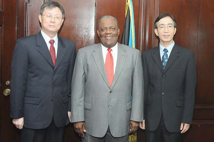 Former Prime Minister, the Rt. Hon. Hubert Ingraham met with the first official Chinese delegation to visit The Bahamas in 2008. From left are: Ju Lidong, Director-General; International Department of the Central Committee Communist Party of China, Prime Minister Ingraham and His Excellency Hu Ding Xian, Ambassador Extraordinary and Plenipotentiary from the People's Republic of China to The Bahamas. (BIS Photo/Peter Ramsay)