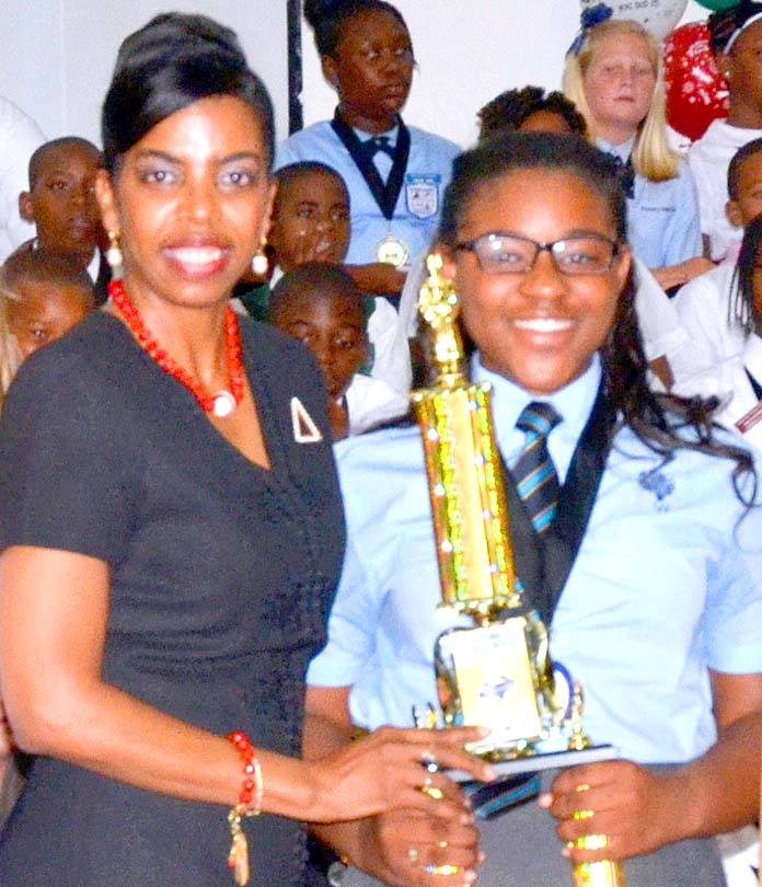 Ms. Myra Mitchell, BTC Project Management Office and BTC scholarship recipient, Ms. Latajha Beneby, first runner up, Bahamas Primary School Student of The Year.