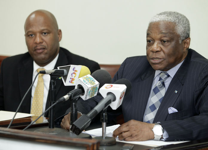 Minister of National Security, the Hon. Dr. Bernard J. Nottage (right) addressed members of the media during a press conference Tuesday at the Ministry of National Security.  Also pictured is Minister of State for National Security, Senator the Hon. Keith Bell.   (BIS Photo/Derek Smith)