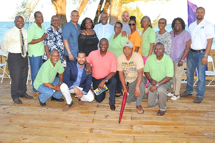 SOME OF THE BAHAMIAN INVESTORS - During the Blessing of the Grounds for Pirate's Cove, the newest tourist attraction in Grand Bahama, a number of the Bahamian investors are seen with Tourism Minister, the Hon. Obie Wilchcombe (standing centre), and President of Arawak Adventure and Commercial Tours Co. Ltd., David Wallace (kneeling in pink shirt). Also shown are Grand Bahama Port Authority President, Ian Rolle (standing fourth from left); Derek Newbold, Business Development Manager, GBPA (far right).  (BIS Photo/Vandyke Hebpurn)