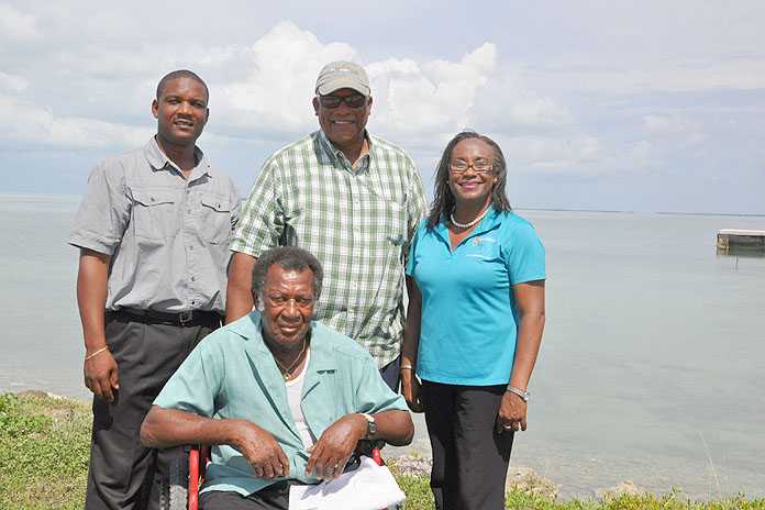 """WEST END SNAPPER TOURNAMENT - The 6th Annual West End Snapper Tournament will be held on Saturday in West End. Shown from left, standing are: Jeff Pinder, Ministry of Tourism; Keith Cooper, Committee Member; and Elaine Pinder, Ministry of Tourism. Seated is Honouree Dencil """"Rambler"""" Grant. (BIS Photo/Vandyke Hepburn)"""