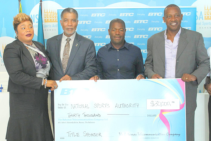 BTC presents $30,000 cash and in-kind cheque to the National Sports Authority for the Haiti vs. Jamaica Soccer Match. Left to Right: Eldri Ferguson-Mackey, BTC Vice President Marketing, Brand and Communications, Leon Williams, BTC CEO, Lynden Maycock, Chairman, National Sports Authority and Anton Sealy, Secretary General, Bahamas Football Association.