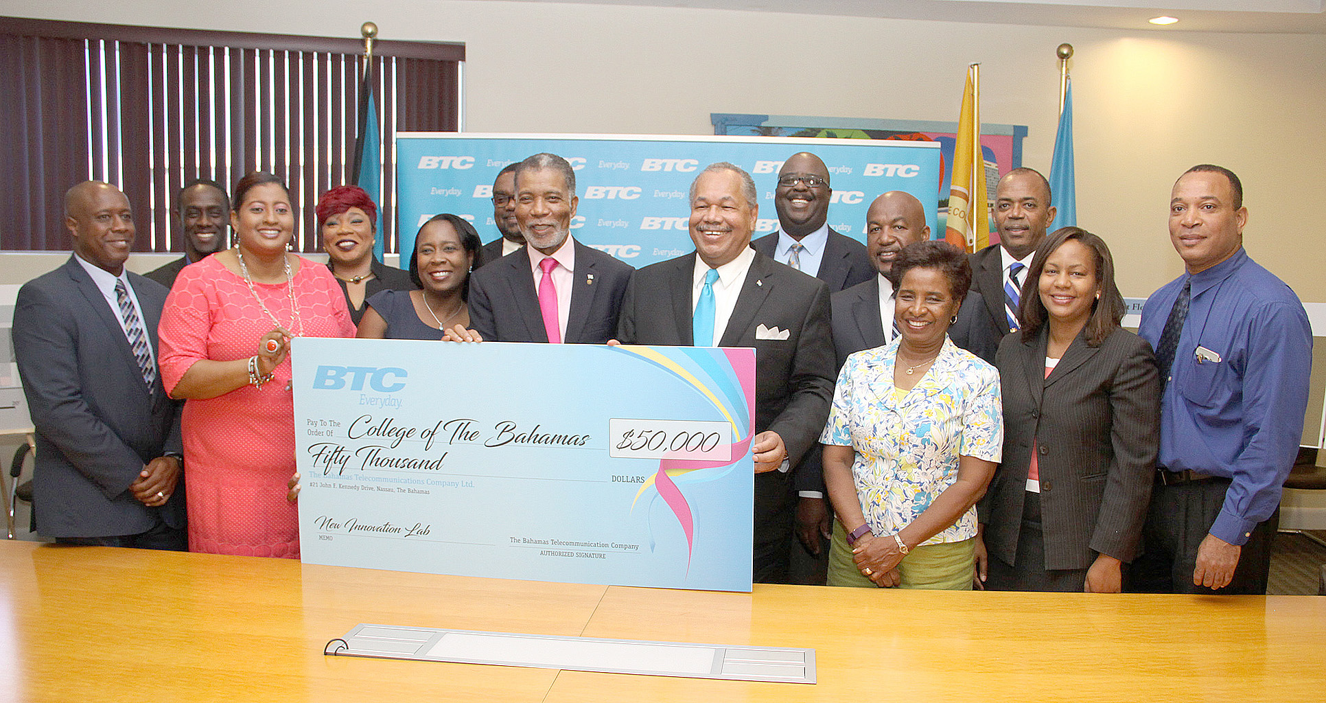 CEO of Bahamas Telecommunications Company Ltd. (BTC) Leon Williams (left) and College of The Bahamas (COB) President Dr. Rodney Smith share handshake following the signing of a Memorandum of Understanding at the College of The Bahamas on July 14, 2016.  They are flanked by representatives of BTC and COB.