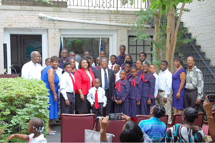Following their concert on the patio of The Bahamas Embassy, The Bahamas National Children's Choir, the National Boys' Choir of The Bahamas and Rhythm 'N Youth posed for this group photo. At center in front row are His Excellency Dr. Eugene Newry, Bahamas Ambassador to the United States, and Mrs. Paulette Zonicle, Bahamas Consul General to Washington, D.C. Far left is H.E. Carlton L. Wright, former Bahamas Ambassador to Cuba, and second from left, Mrs. Audrey Dean-Wright, Director of the Choir. Far right is Mr. Luicito Bazard, former Haiti Consul to The Bahamas, and second from right, Mrs. Patricia Bazard, General Director of the Choir.