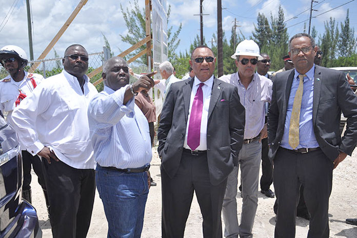 Deputy Prime Minister and Minister of Urban Development, the Hon. Philip Davis (second from left) is seen pointing out something to Prime Minister and Minister of Finance, the Rt. Hon. Perry Christie (centre) at the Fishing Hole Road, Friday, June 24, 2016. Also shown from left are The Hon. Arnold Forbes, Minister of State, Minister of State for the Ministry of Works and Urban Development; Wolfgang Geiger, President, All Bahamas Construction Company, contracted to do the roadwork; and Minister for Grand Bahama, Dr. the Hon. Michael Darville. (BIS Photo/Vandyke Hepburn)