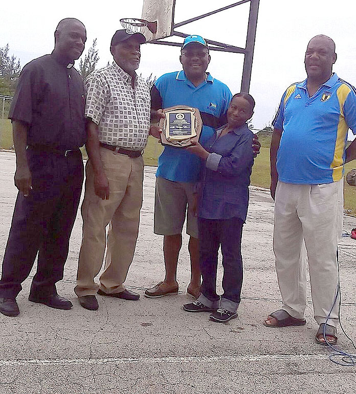 HONOURED – Wilfred Bevans, a long-serving Local Government official, was honoured for more than 20 years of service to Local Government. The presentation took place this past Saturday, July 2, at the YMTA Field in Hunters.  Left to right in the photo are: Deacon Donald Duncombe, Mr. Bevans, Ms. Russell, Mr. Grant, and Simon Lewis, Councilor, West Grand Bahama District.  (Photo/Courtesy Terrance Bain)