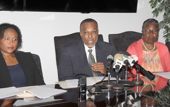 Dr. Glen Beneby, Chief Medical Officer, Ministry of Health (centre) addressing members of the media during a press conference held at the Ministry's Headquarters Tuesday, July 26, 2016. Also pictured (at left) is Dr. Pearl McMillan, Director of Public Health and Maisie Evans, Permanent Secretary, Ministry of Health (far right). (BIS Photo/Letisha Henderson)