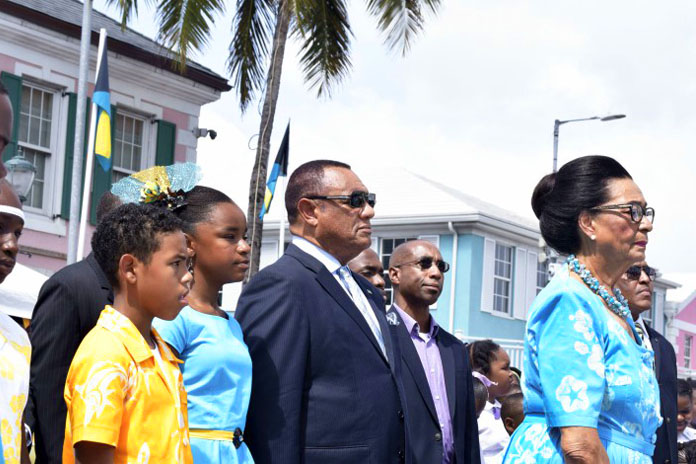 All stand at attention during the playing of the National Anthem - March on, Bahamaland - by the Royal Bahamas Police Force Youth Band, during the National Pride Day and Flag Raising Ceremony. Pictured are the Rt. Hon. Perry Christie, Prime Minister and Her Excellency Dame Marguerite Pindling, Governor General. (BIS Photo/Derek Smith)