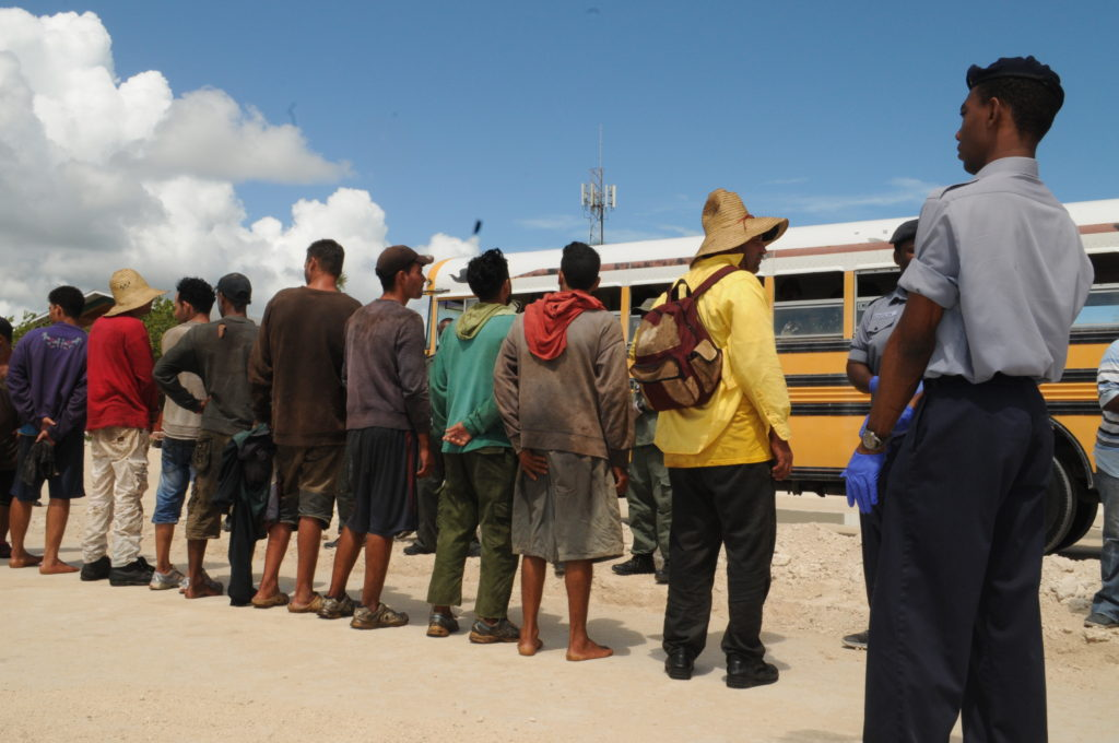 Cuban migrants awaiting to be transported to the Carmichael Road Detention Center. The 14 migrants were apprehended of Highbourne's Cay in the Exuma Sound.