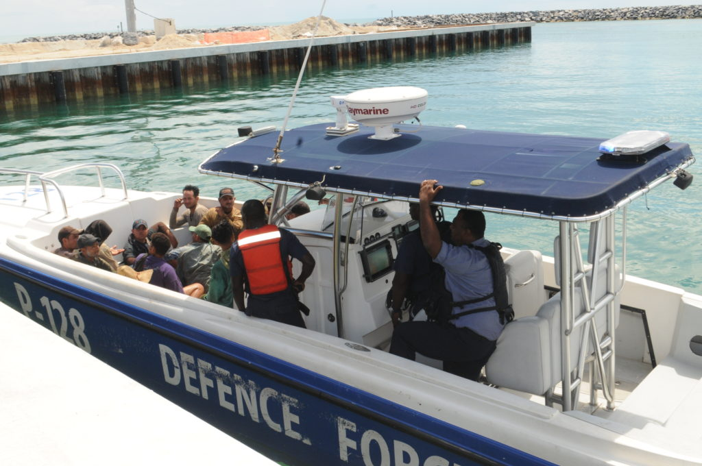 Defence Force patrol craft P-128 arriving at the Coral Harbour Base with 14 Cuban migrants. The migrants were transported to the Carmichael Road Detention Center.