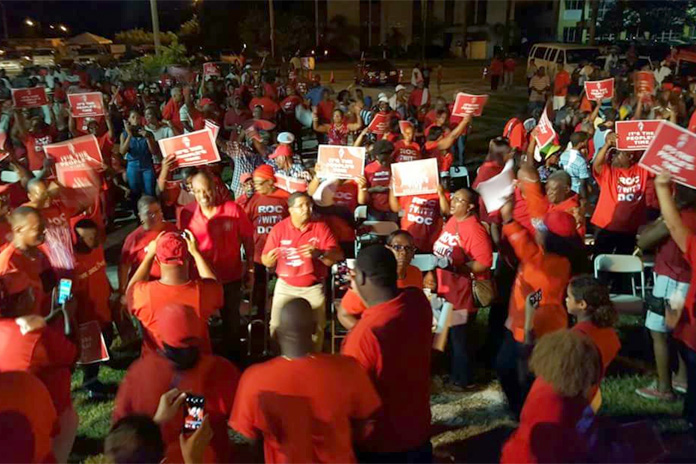 Dr. Hubert Minnis and Deputy Leader Peter Turnquest flanked by supporters tonight on Grand Bahamas.