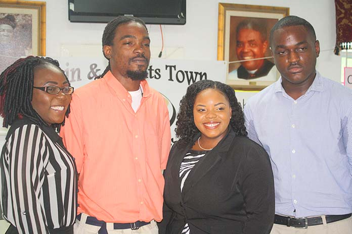 Four Bain and Grants Town residents are able to pursue higher learning as the first recipients of the Bain and Grants Town Scholarship Fund. From left to right are: Nadia Esteve, AA Accounting, Galilee College; Vandeco Stuart, certificate in Electrical Installation, BTVI; Terwaashna Robinson, AAS, Office Administration and Michael Clarke, BA Accounting, COB.