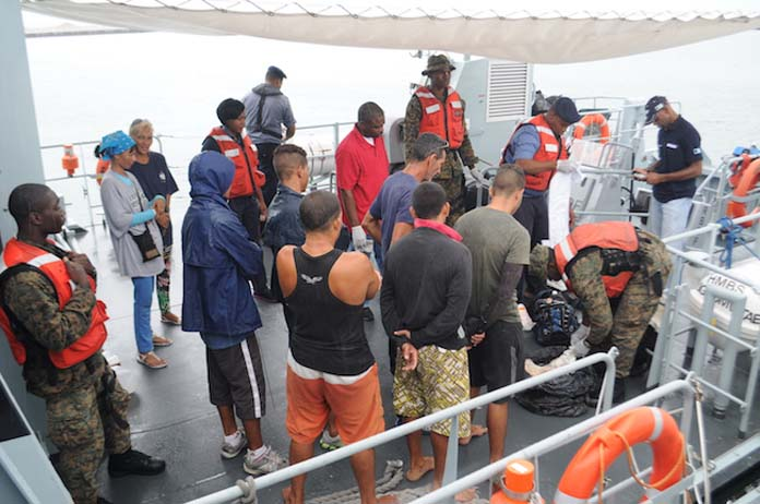 RBDF Marines conducting a thorough search of Cuban Migrants and their personal items aboard Defence Force patrol craft, HMBS Lignum Vitae. (Photo: Able Seaman Drissen Brennen)