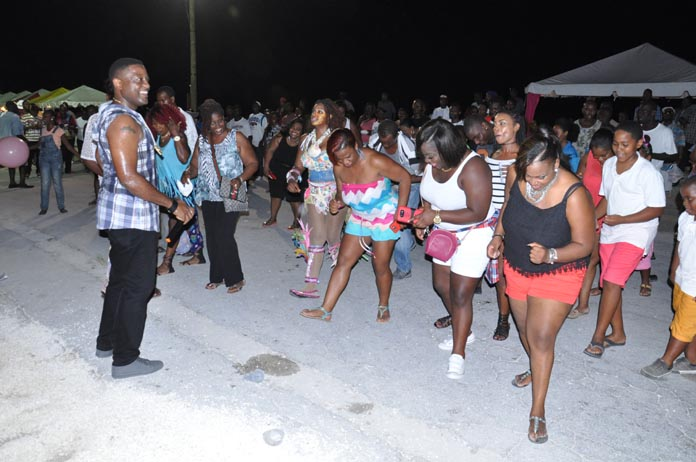 JOINING IN THE FUN - The Ministry of Tourism's 2nd Annual Junkanoo Summer Festival closed out in West End, Grand Bahama, on Saturday, August 20, 2016.  At the closing, the Ministry of Tourism was able to attract some 400 tourists to enjoy an incredible experience. Ms Betty Bethel, Director of Tourism, said she has no doubt they will share their experience with friends and family when they return home. Seen is one of the guests enjoying the festival. (BIS Photo/Vandyke Hepburn)