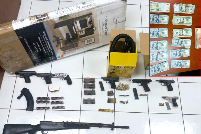 Weapons and cash found by police. One suspect under arrest.