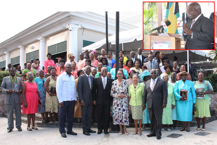 The honourees are pictured along with officials including Governor-General Dame Marguerite Pindling; the Hon. Philip Davis, Deputy Prime Minister and Minister of Works and Urban Development; and the Hon. Obie Wilchcombe, the Minister of Tourism. The Hon. Philip Davis, Deputy Prime Minister and Minister of Works and Urban Development, speaks at the 4th Recognition and Appreciation Ceremony for Straw Vendors and Practitioners, and Wood Carvers.