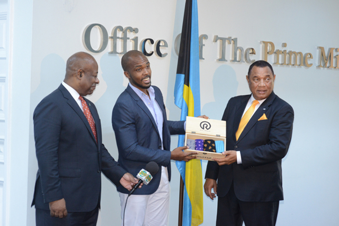 Prime Minister Christie, Businessman Jerrel Hall and Minister Obie Wilchcombe.