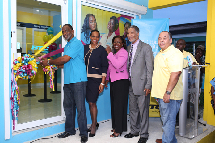 The Official Ribbon Cutting to the First Creole BTC Franchise Store. Left to Right Robert Dieudonne (Franchise Store Owner), Patricia Walters (Senior Vice President Customer Services), Janet Brown (Chief Marketing Officer), Leon Williams (CEO), Dwight Gibson (BTC Franchise Operations Manager)