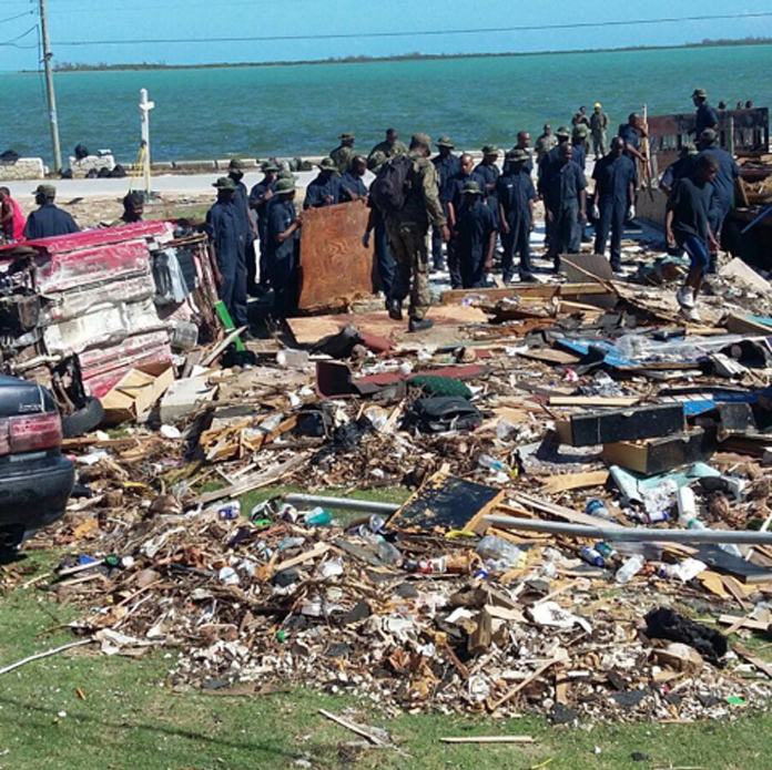 Marines of the Royal Bahamas Defence Force and other volunteers engaged in a massive clean-up effort of debris in North Andros, which experienced Hurricane Matthew as a Category 4 Storm on Thursday, October 6, 2016. (PHOTO/Leonard Dames Jr/NEMA)