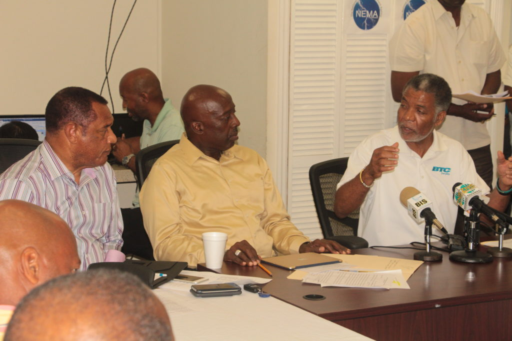 Leon Williams, CEO of BTC giving an update  on the telecommunications restoration efforts following the passage of Hurricane Matthew, at a press conference held Sunday, October 9, 2016 at NEMA on Gladstone Road. Picture left is the Rt Hon Perry Christie, Prime Minister, and the Hon Shane Gibson, Coordinator for the Hurricane Matthew Relief and Recovery efforts. (BIS Photo/Eric Rose)