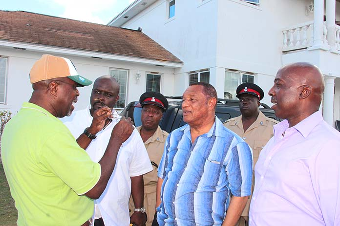 George Wilson presents to Prime Minister Christie the state of his community following Hurricane Matthew.