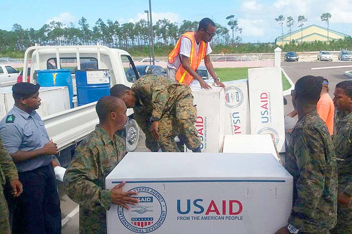 Royal Bahamas Defence Force marines loading tarpaulin on the back of trucks for distribution to residents in New Providence, who suffered roof damages during the passage of Hurricane Matthew last week. (PHOTO/NEMA)