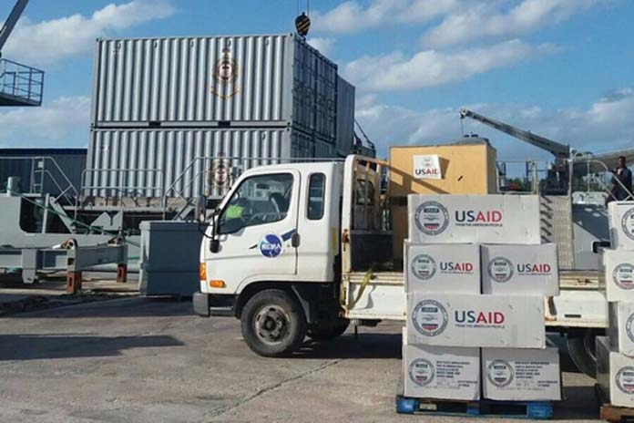 Relief supplies donated by the United States Agency for International Development/Office of Foreign Disaster Assistance (USAID/OFDA), being loaded on to The HMBS Lawrence Major on Tuesday, October 11 with much needed supplies for residents in North Andros, one of the areas hardest hit by the Category 4 Hurricane Matthew. (PHOTO/NEMA)