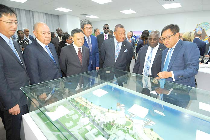 Prime Minister the Rt. Hon. Perry Christie, centre right, and DEPUTY PRIME MINISTER Philip Brave Davis review an architectural rendering of The Pointe, downtown, with investors and officials.  (BIS Photo/Peter Ramsay)
