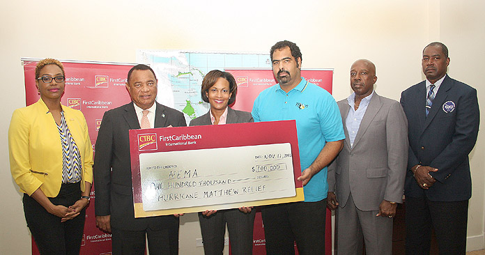 CIBC FirstCaribbean donated $100,000 to the Hurricane Matthew recovery and restoration efforts, during a presentation at the National Emergency Management Agency on Thursday, November 17, 2016. Pictured left to right are: Maya Nottage CIBC FirstCaribbean Marketing & PR Manager; the Rt. Hon. Perry Christie, Prime Minister; Marie Rodland-Allen, CIBC FirstCaribbean Managing Director; Gowon Bowe, member of the disaster relief committee responsible for accounting and fund raising; the Hon. Shane Gibson, Minister responsible for Recovery and Restoration; Captain Stephen Russell, Director, NEMA.  (BIS Photo/Patrick Hanna)