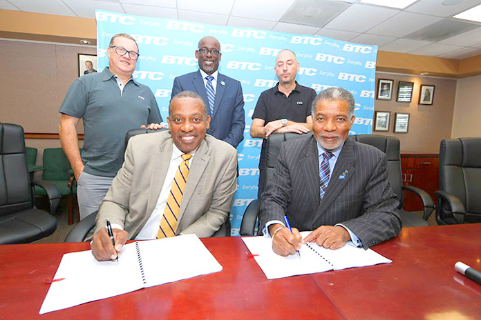 BTC & FIFA sign National Partner contract for exclusive telecommunications services. Back Row L to R: Joan Cusco (President Beach Soccer Worldwide), Jeffrey Beckles (LOC Chairman), Jaime Yarza (Director of Competitions, FIFA). Seated. Anton Sealy (BFA President), Leon Williams (CEO, BTC)