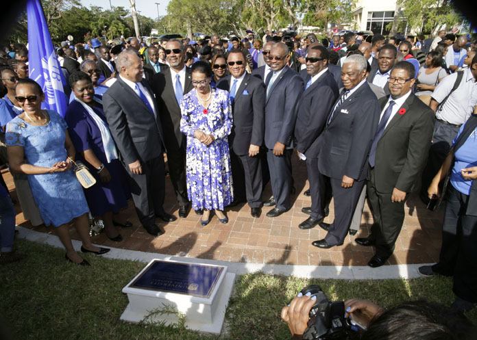 Governor General, Her Excellency Dame Marguerite Pindling, centre, unveils the plaque at the entrance of new University of the Bahamas during the University Charter Day Plaque Unveiling Ceremony held on Thursday, November 10, 2016.   Also pictured: Prime Minister and Minister of Finance the Rt. Hon. Perry Christie (centre left), Leader of the Opposition the Hon. Dr. Hubert Minnis (centre, second left); Minister of Education, Science and Technology the Hon. Jerome Fitzgerald (centre right), and President of the University of The Bahamas Dr. Rodney Smith (centre, second right).  In the second photo, it's all smiles at the sight of the new University of The Bahamas plaque.  (BIS Photos/Derek Smith)