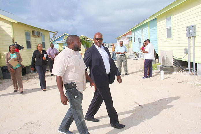 Minister with responsibility for Hurricane Relief and Restoration the Hon. Shane Gibson, centre, views the aftermath and restoration of Chub Cay.  (BIS Photo/Patrick Hanna)