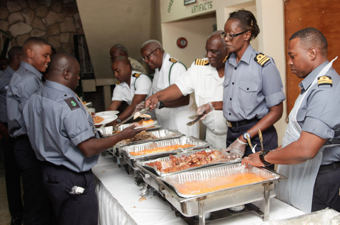 Defence Force officers serving the Marines during the Thanksgiving luncheon held at the Defence Force Base.
